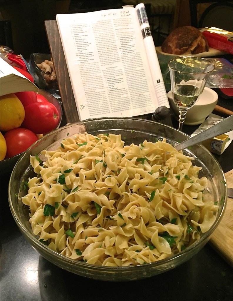 Big bowl of parsley buttered egg noodles.