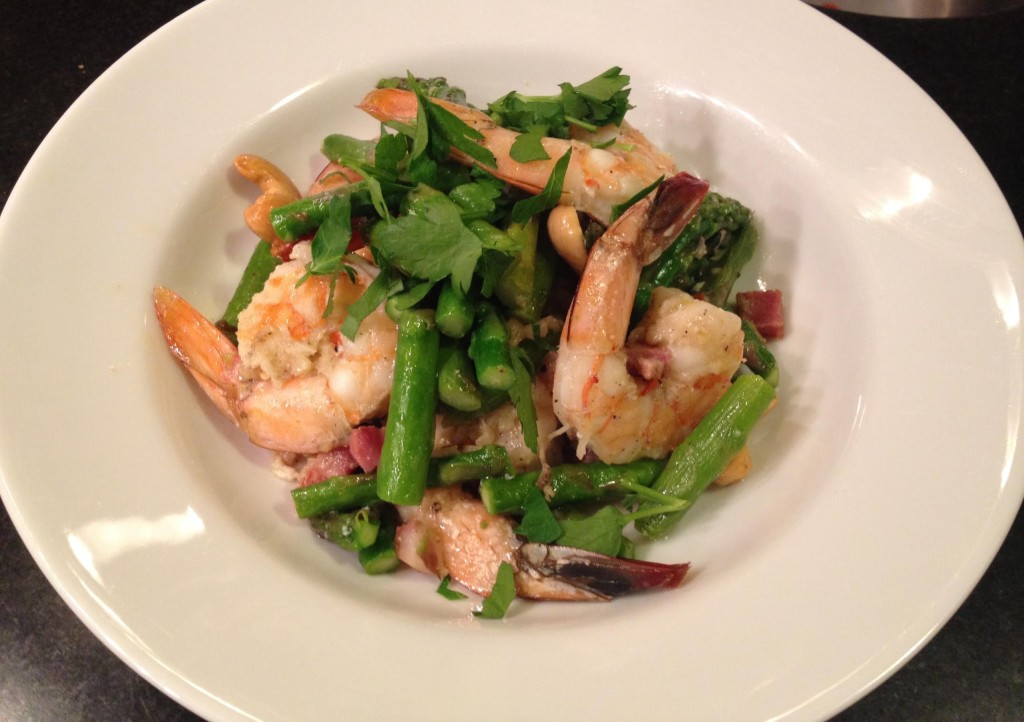 Shrimp and asparagus in a white bowl.