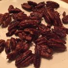 Rufus Teague Roasted Pecans on a cream colored plate.