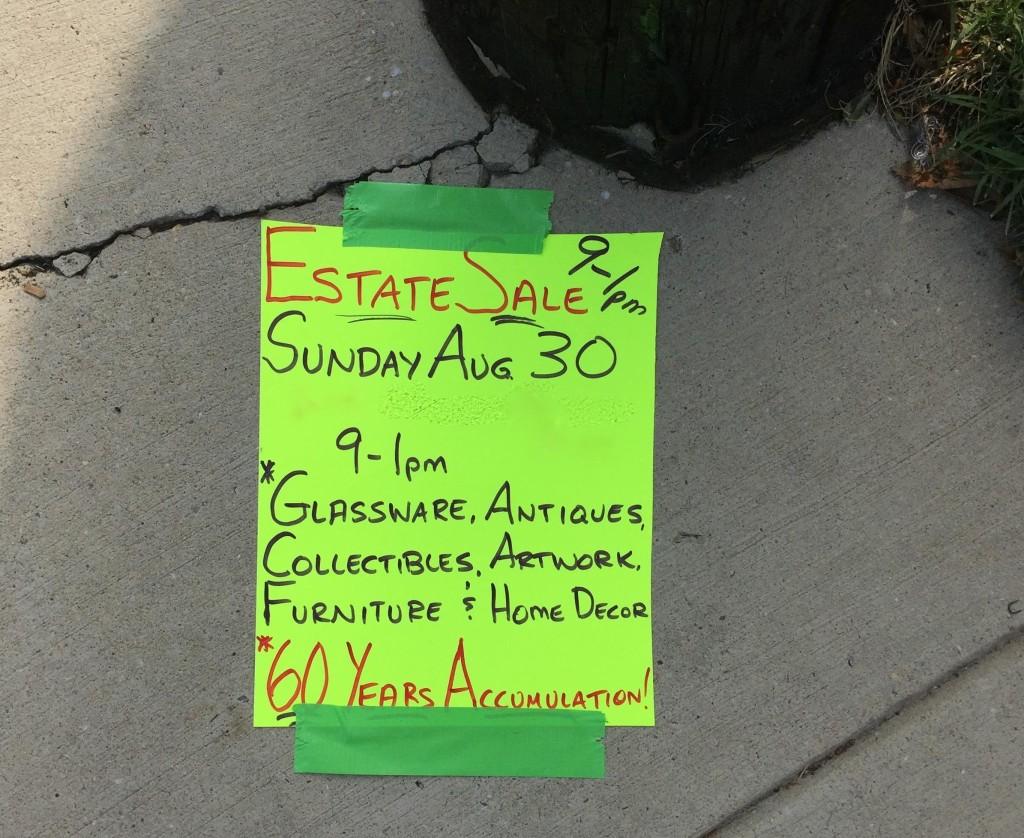 Estate sales sign on the sidewalk in Baltimore.