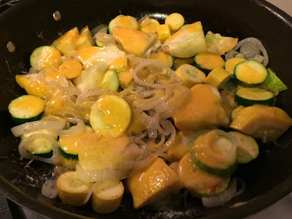 Easy cheesy sauteed squash finished in a skillet.