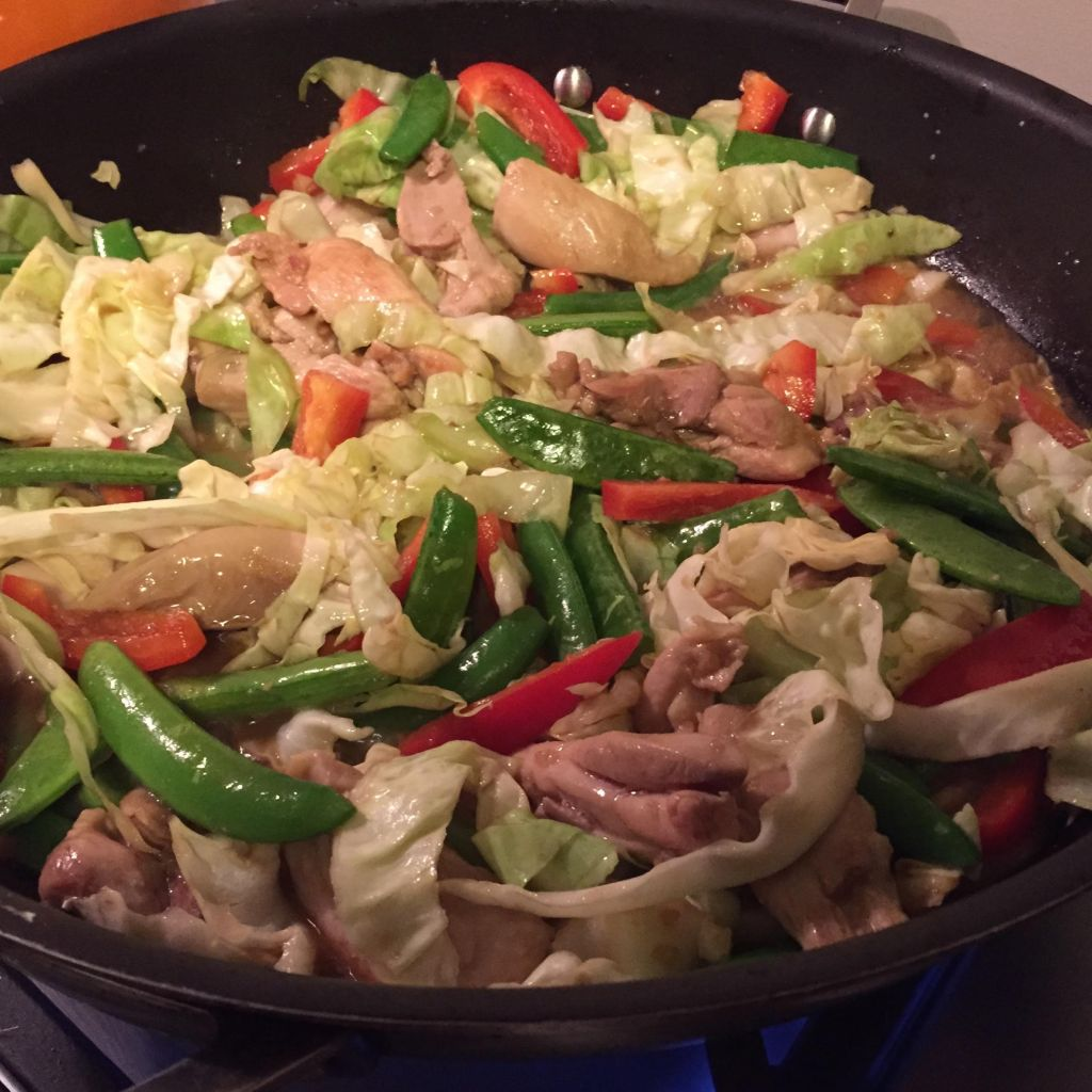 Super quick chicken and summer vegetable stir-fry in a skillet.