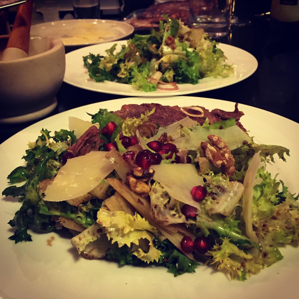 Chicory salad with pomegranate seeds.