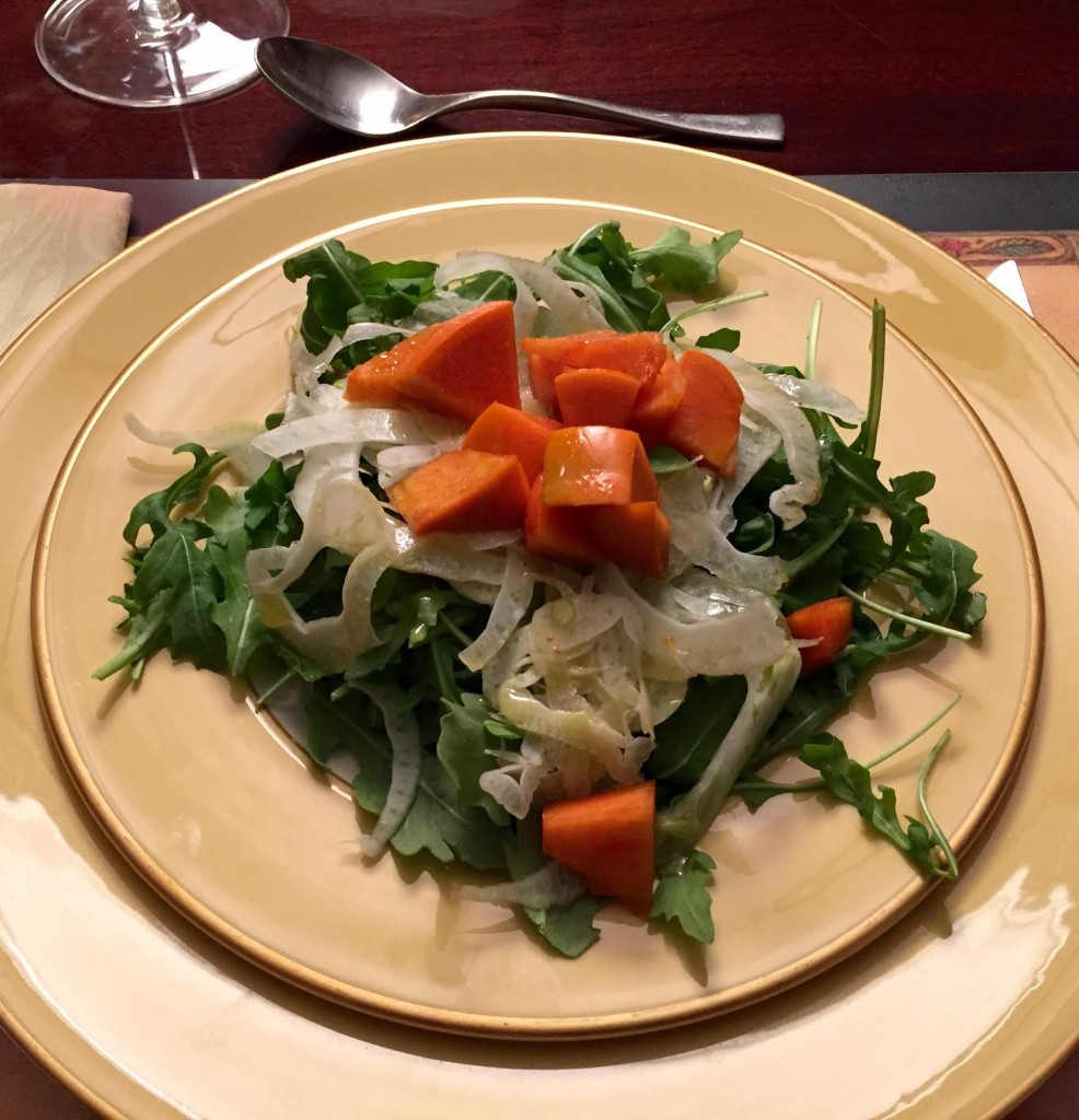 Arugula, fennel and persimmon salad overhead shot.