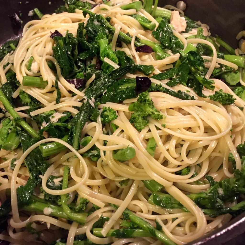 Quick Pasta with Broccoli Rabe, Tuna, olives and slow roasted tomatoes - pasta and rabe in a skillet.