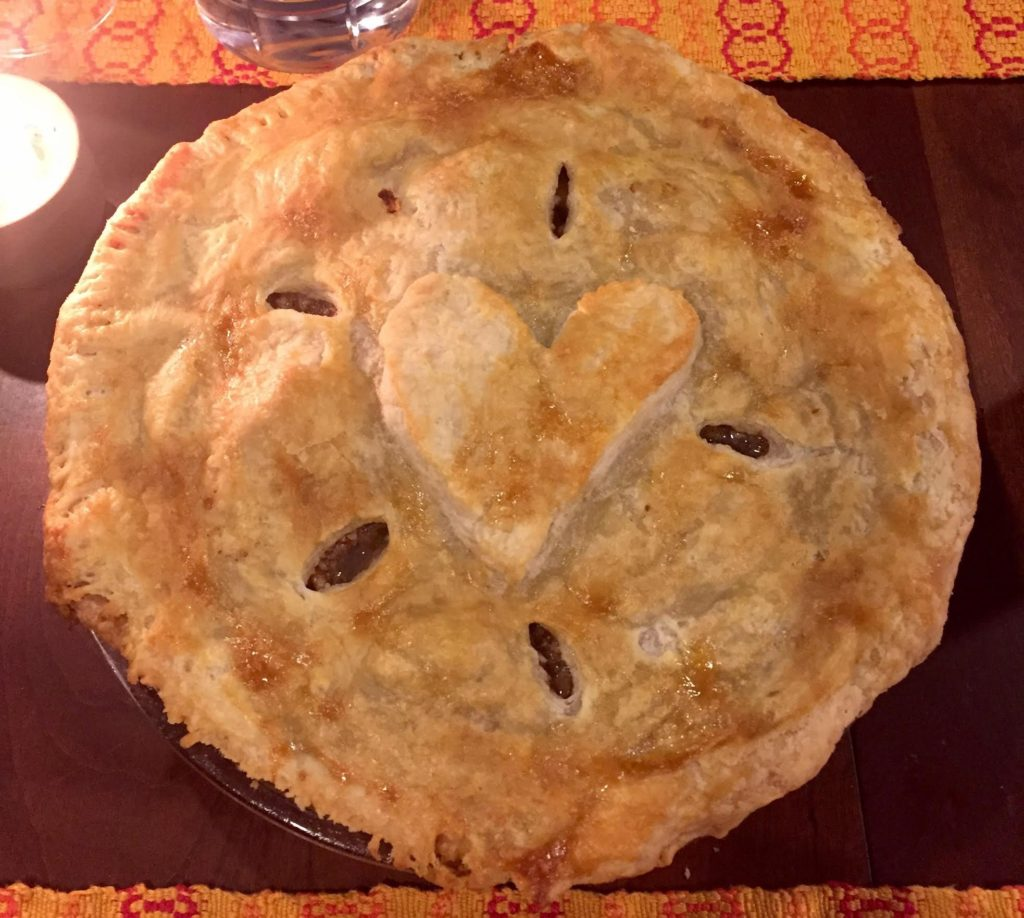 Pear pie with a heart on top.