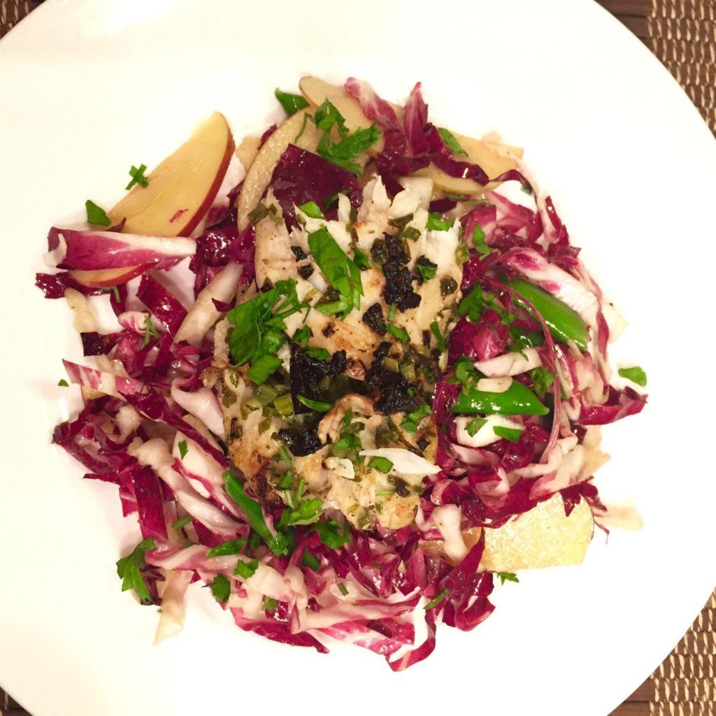 Roasted sea bass fillets on a radicchio, sugar snap peas and apple salad.