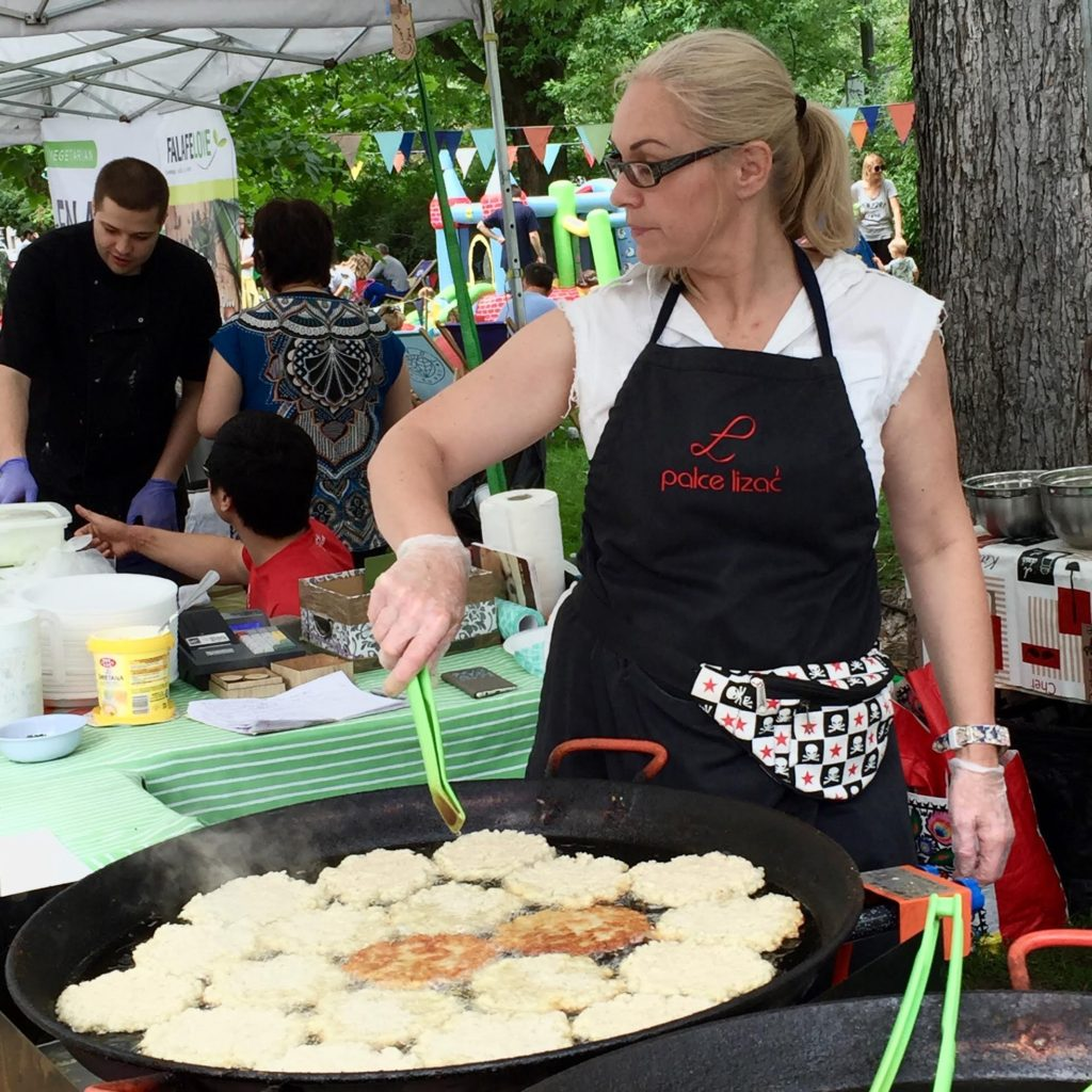 Making potato pancakes at the breakfast market - Targ Śniadaniowy in Warsaw on Sundays.