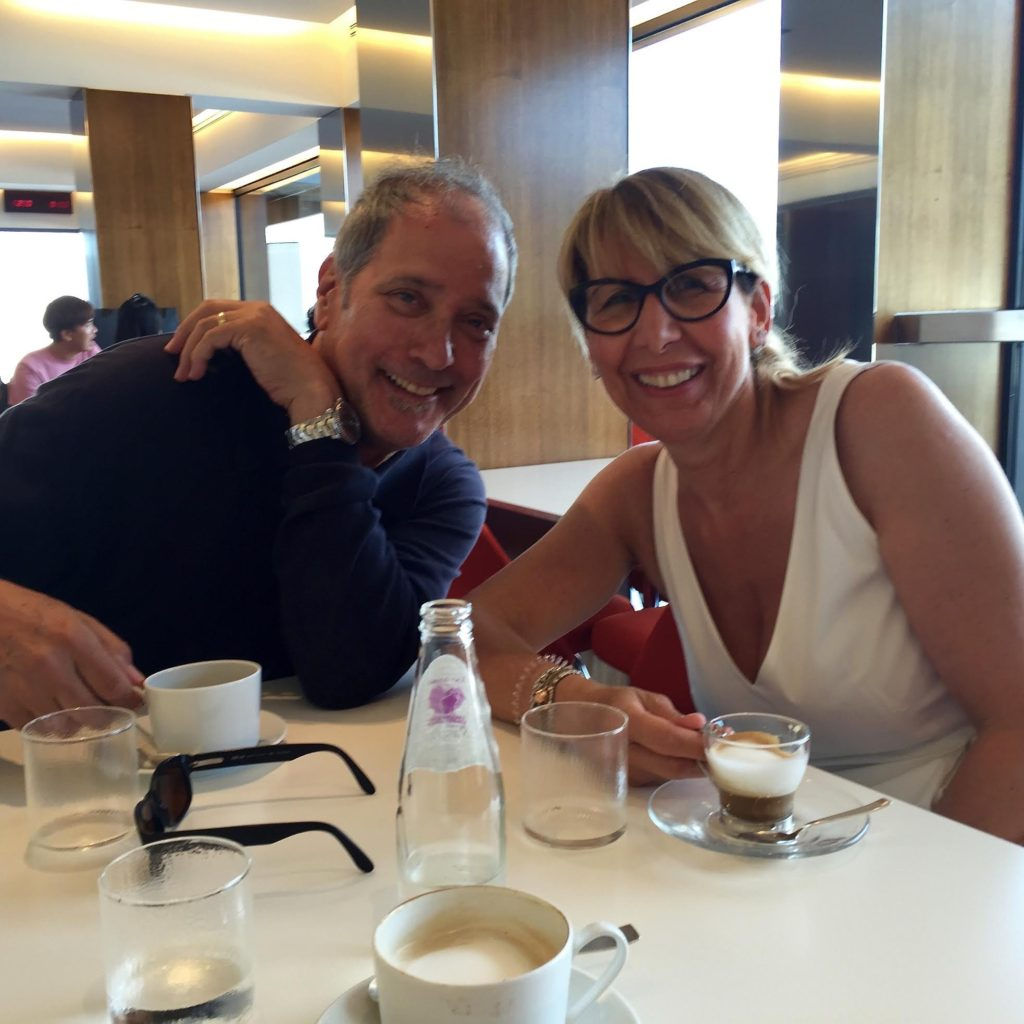 Steve Mazur and Christina having coffee a the Prada shop.