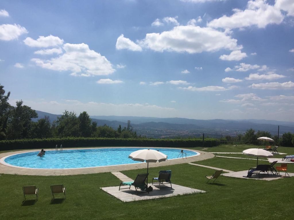 Hotel pool in Tuscany overlooking Arezzo.