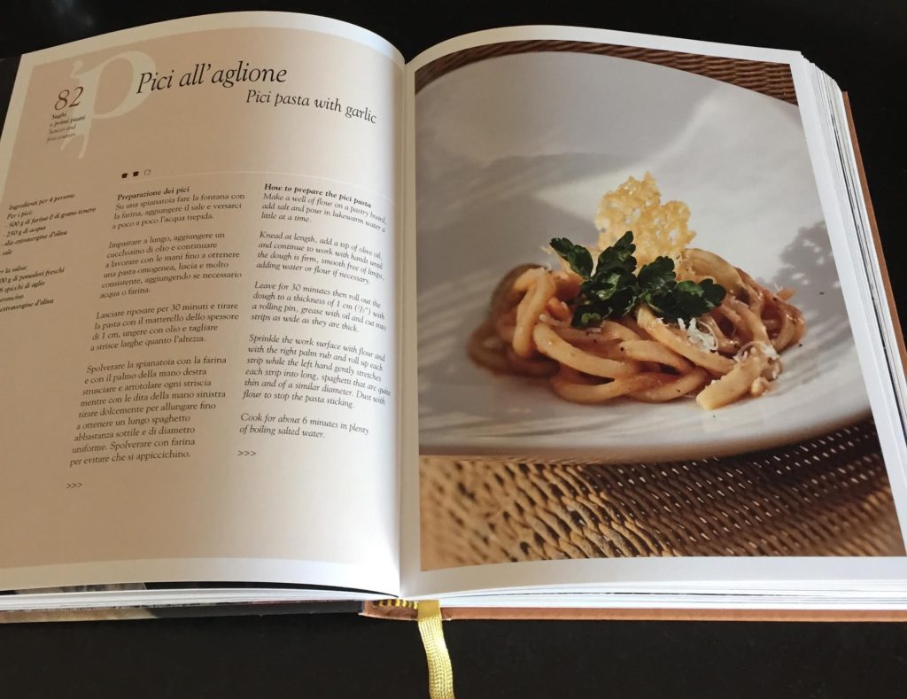Tuscan cookbook open to Pici pasta recipe.