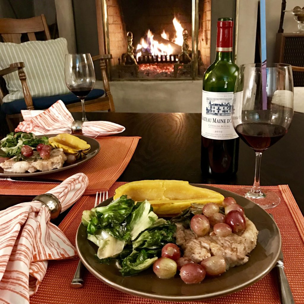 Braised Veal Chops with Honey and Red Grapes in front of a roaring fire.