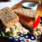 Tuna Salad Sandwiches with Holy Schmitt's Mustard Horseradish on a blue and white plate.