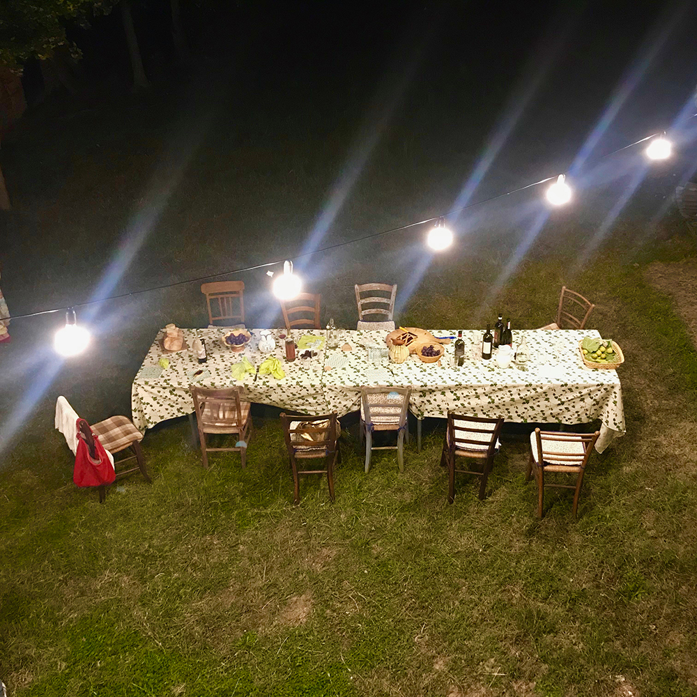 An overview of the table from a house window after the dinner.