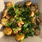 Grilled Potato Salad garnished with parsley.