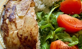 Ginger-crusted halibut with rice and salad.