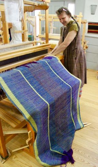 A blanket coming off the loom