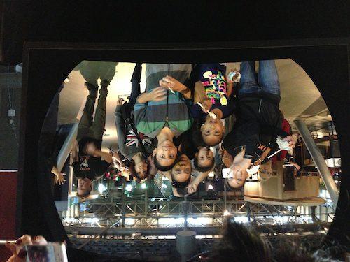 Having fun posing in front of Giant Curved Mirror at the San Francisco Exploratorium - © LoveToEatAndTravel.com