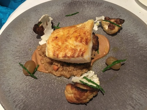 Lightly Spiced Brill, Roasted Cauliflower, grapes, Confit potato, Curry Oil entree at The Dower Restaurant at The Royal Crescent Hotel & Spa in Bath, UK - photo © Love to Eat and Travel