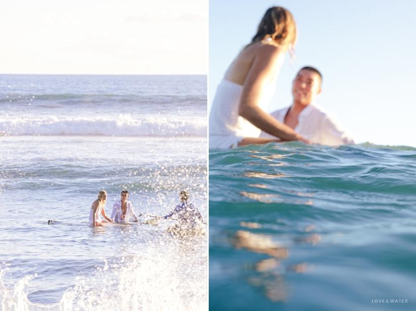 Maui surfboard wedding photography www.lovewaterphoto.com #maui #hawaii #elopement #surfboard #wedding #destinationwedding #bride #weddingphotography