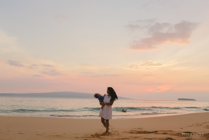 Mother twirling son at sunset Maui family portrait