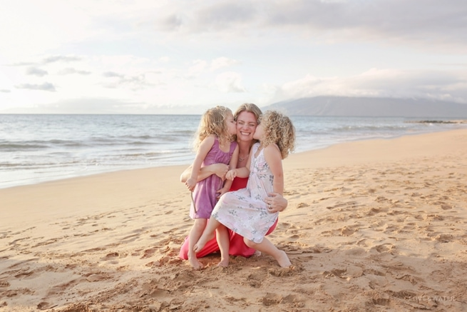 Mother and daughters at the beach in Maui