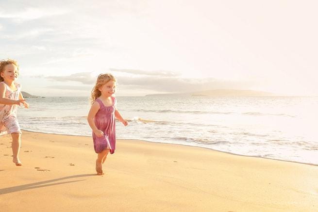 Girls running on the beach Maui