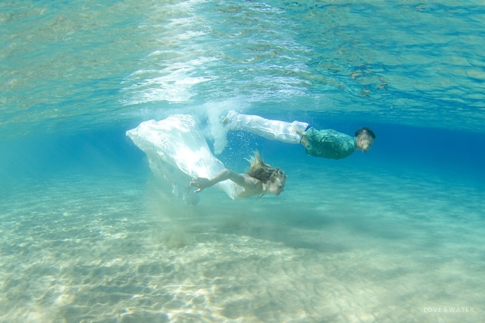 Underwater photographers Maui trash the dress