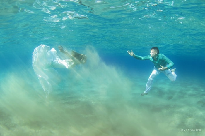 Couple underwater trash the dress Maui