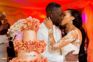 Ghanaian Wedding Couple Kiss with cake Bema and Cherelle Adjei-Ampofo JOT Photography LoveWeddingsNG