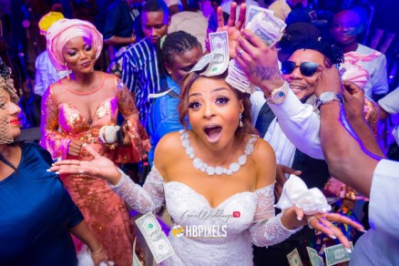 Nigerian White Wedding OritseFemi and Nabila Groom Spraying Money LoveWeddingsNG 1