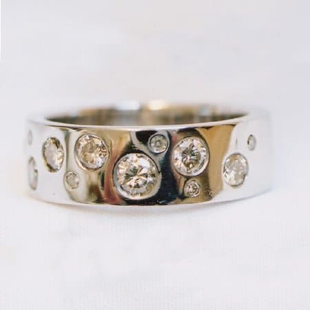 9ct-white-gold-ring-rhodium-plated-flush-set-with-10-brilliant-cut-diamonds-261