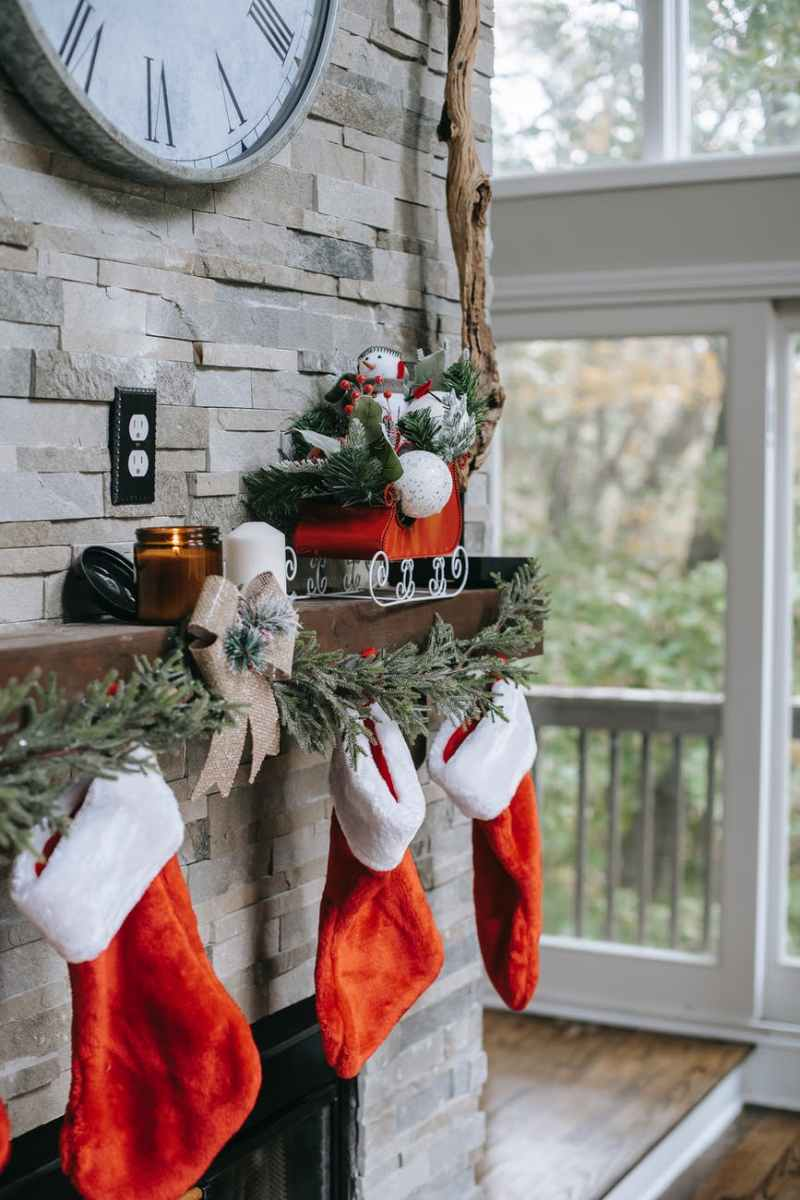 xmas decorations on brick wall above fireplace