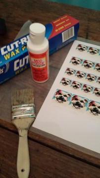 Supplies for sealing your paper art with ModPodge before applying ice resin.