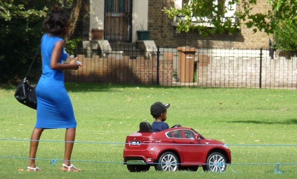 Child in a baby BMW: conspicuous consumption in London Fields Hackney London E8 290714 © david.altheer@gmail.com