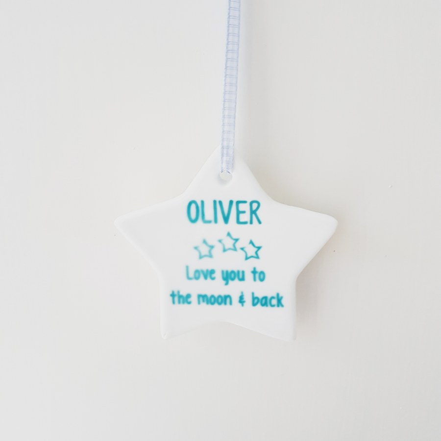 Ceramic star with personalised message in blue