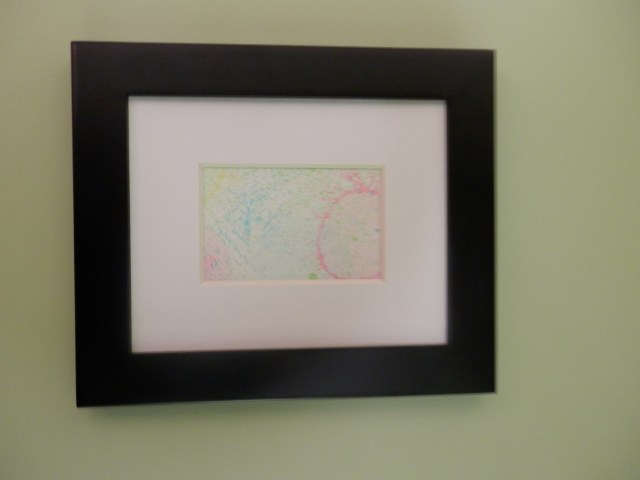 "A child's framed ""bubble art""."