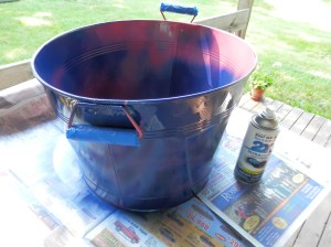 Spray painting old beverage tub!