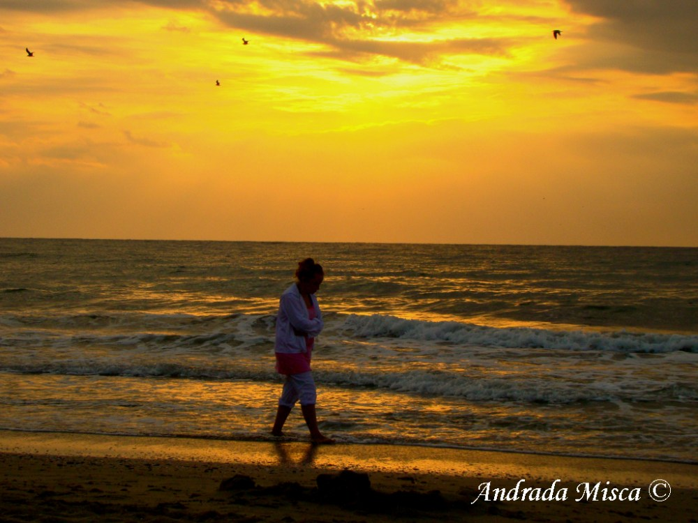 Woman on the beach at sunrise no 3