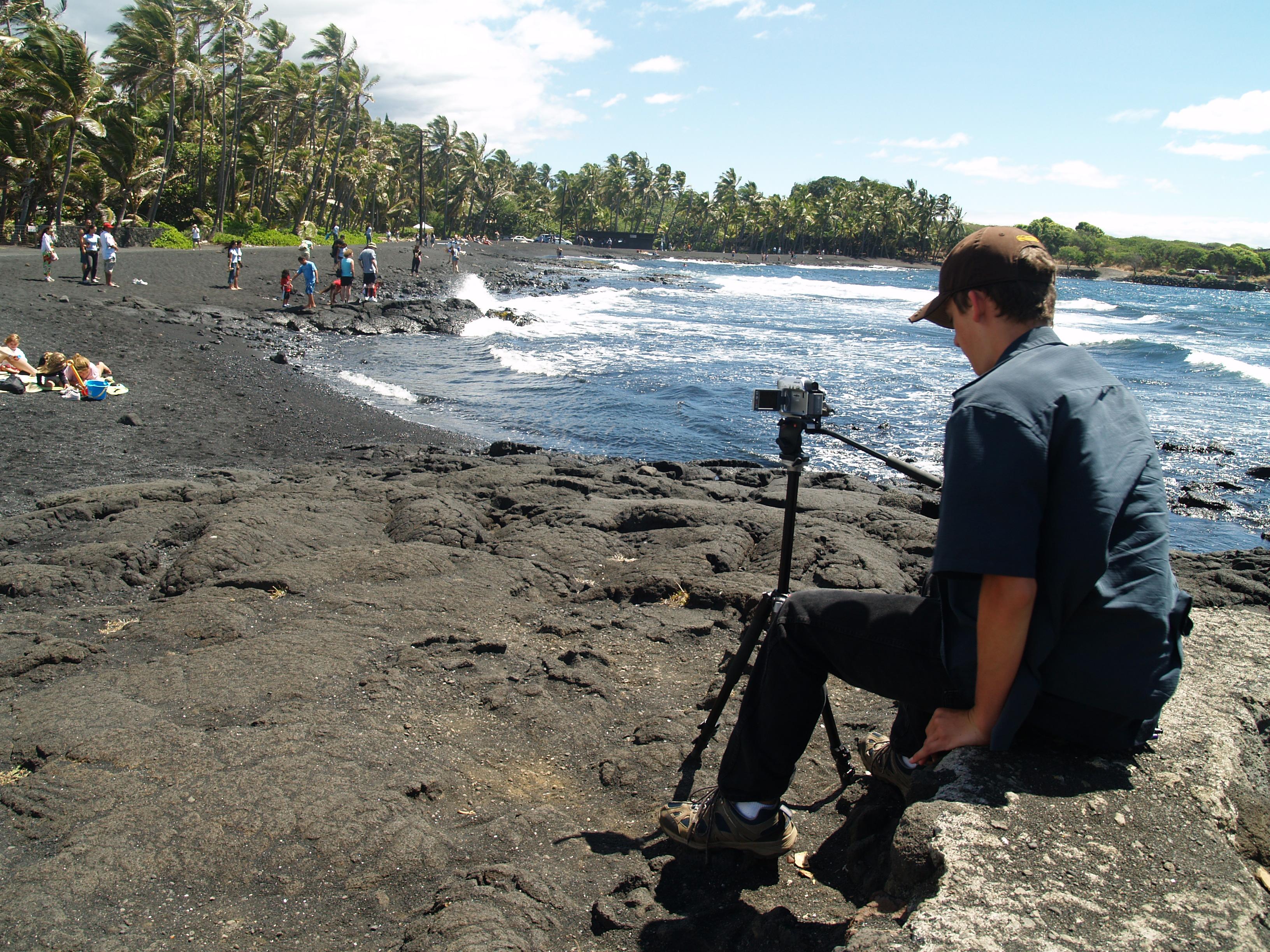 Bradford MacGowan Filming at Punalu'u Black Sand Beach, Ka'u Hawaii: Photo by Donald MacGowan