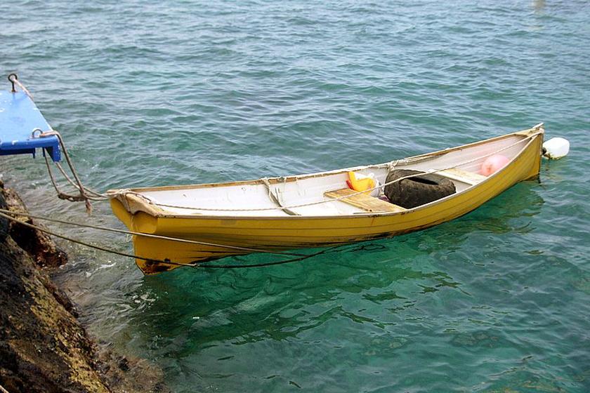 A Hand-Built Boat Tied-up at Kailua Pier, Kailua Kona, Hawaii Photo by Donnie MacGowan