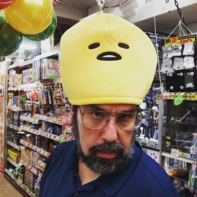 Jason in a Gudetama hat at Don Quijote