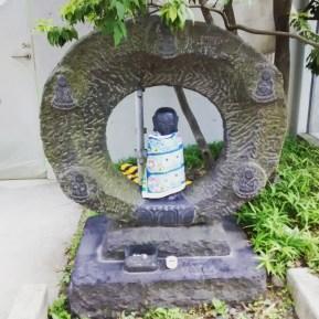 Fashionable Buddha outside A Bathing Ape store