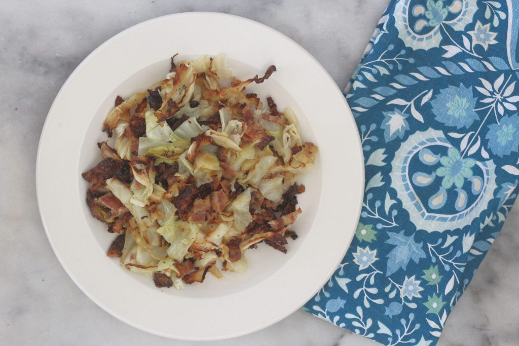 This simple sheet pan bacon and roasted cabbage is so full of flavor and easy to make with only two ingredients. Make this easy low carb bacon and roasted cabbage as a veggie side dish for those keto dinners. #lowcarbdelish #ketovegetables #lowcarbsides #ketosidedish #bacon