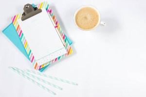 white ceramic teacup beside grey paper clip