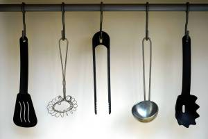 black plastic spatula hanged on black hook