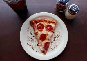 sliced pepperoni pizza on white ceramic plate