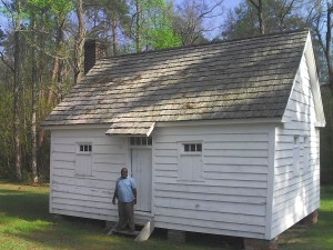 Joe McGill at Door of Slave Cabin