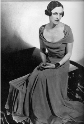 """photograph of Sophie Gimbel (AKA """"Sophie of Saks"""") wearing a coral crepe Vionnet dress, 1933. Sophie was married to Adam Gimbel, owner of the department store Saks Fifth Avenue, NY"""