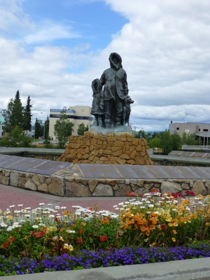 "Statue of the 'Unknown First Family' at the center of Golden Heart Park near the river in ""old town"" Fairbanks."